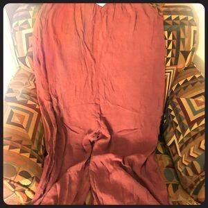 Rose colored sleeves wide leg romper.